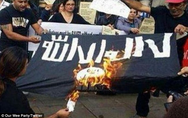 Prompted by social media, outraged Arabs and Muslims burned the ISIS flag.