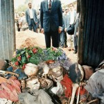 Boutros-Ghali stands before a shed containing the remains of scores of dead killed during a massacre at Nyarubuye Church, in south-eastern Rwanda. Photo: UN