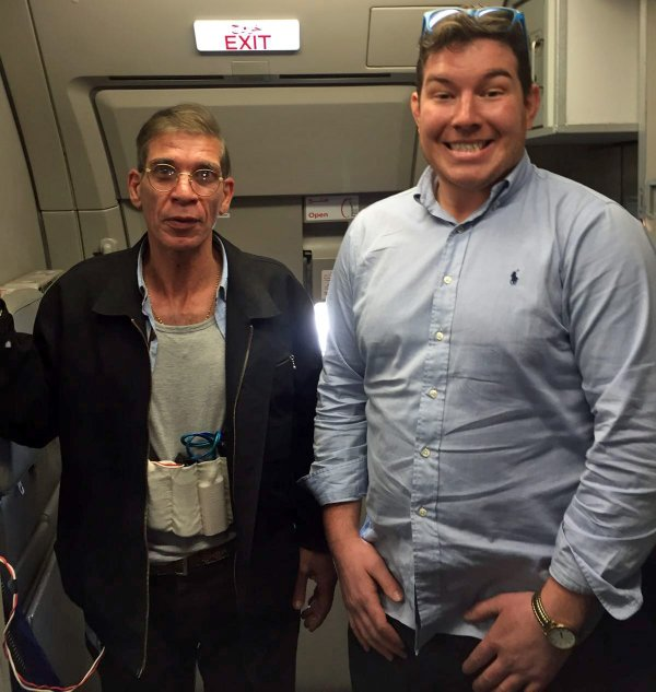 """Lovejacker"" Seif Eldin Mustafa poses for a surreal snap with one of the passengers."